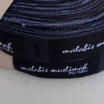 harga label woven damask